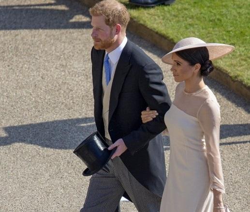 Enrique y Meghan en su primer compromiso oficial tras su boda
