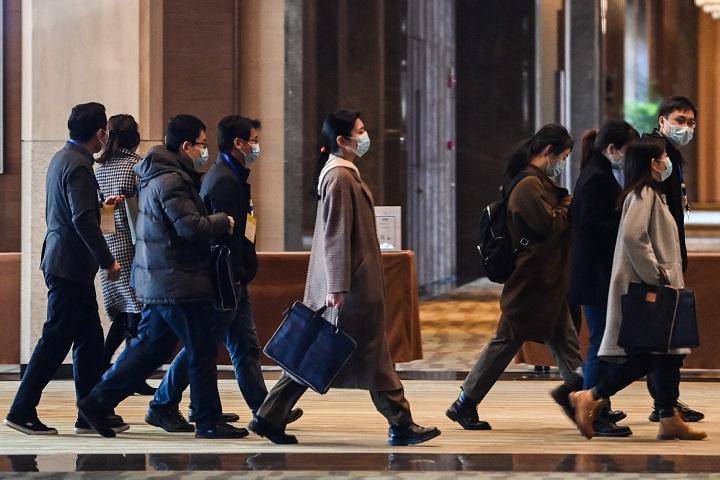 Expertos de la OMS comienzan finalmente en Wuhan su misión en el terreno