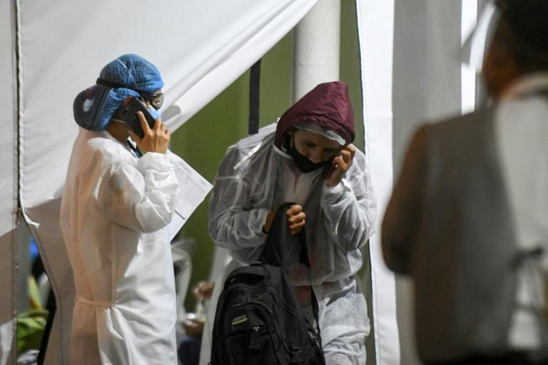 China teme un rebrote de la pandemia, que no da tregua a Brasil
